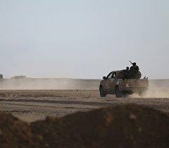 Вооруженные люди на машине в Сирии. Архивное фото