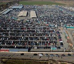 Военно-Антоновкадагы автоунаа базары. Архивдик сүрөт