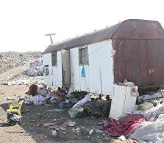 Переселение семьи которые жили рядом со свалкой