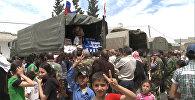 Российские военные раздавали пакеты с продовольствием сирийцам в Хаме и Хомсе