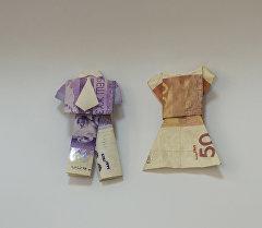 Акчадан жасалган оригами. Архивдик сүрөт