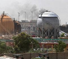 Багдаддын түндүк тарабында жайгашкан газды кайра иштетүүчү заводдогу жарылуунун кесепети.