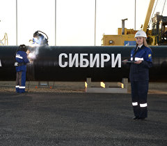 Сварка шва на церемонии соединения первого звена магистрального газопровода Сила Сибири. Архивное фото