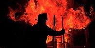Сотрудник пожарной службы. Архивное фото