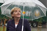 Германиянын канцлери Ангела Меркель Эмсбюрен шаарындагы бала бакчага болгон сапарында
