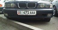 Машина с новыми автомобильными номера на улицах Бишкека. Архивное фото