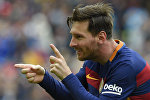 Аргентинский нападающий Лионель Месси празднует во время матча испанской футбольной лиги ФК Барселоны против Эспаньол. Архивное фото