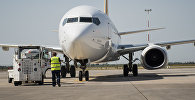 Архивное фото самолета в международном аэропорту Манас