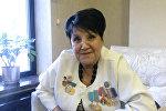 Внучка Ивана Панфилова Айгуль Байкадамова во время интервью