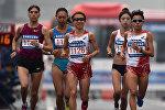 Бегунья на длинные дистанции, участница двух летних Олимпийских игр Юлия Андреева (крайняя слева) во время Олимпийских игр 2014 года в Южной Корее. Архивное фото