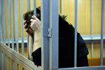 Обвиняемая в камере. Архивное фото