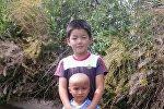 Семилетний Байэль и трехлетний Бекназар, которого он спас