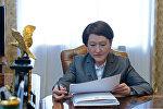 Борбордук шайлоо комиссиясынын төрайымы Нуржан Шайлдабекованын архивдик сүрөтү