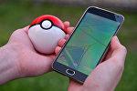 Архивное фото игрового приложения Pokemon Go от компании Nintendo на экране мобильного телефона