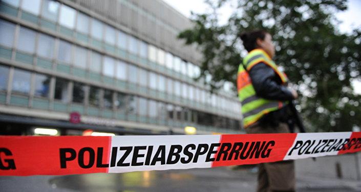 Мюнхенде атышуу болгон жайда полиция кызматкери. Архив