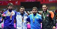 Борец из Кыргызстана Магомед Мусаев(первый слева) на соревнованиях. Архивное фото
