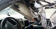 Поврежденный от взрыва автомобиль работника прокуратуры в селе Орто-Сай. Архивное фото