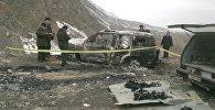 Сожженный автомобиль на котором погиб депутат ЖК Медет Садыркулов. Архивное фото