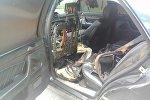 Сгоревший салон автомобиля спикера Каракольского горкенеша Эрлан Айсаракунова