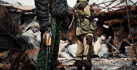 Вооруженные мужчины. Архивное фото