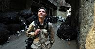 Фотокорреспондент Андрей Стенин на улице Каира. Фото из архива