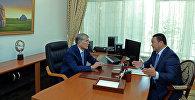 Президент Алмазбек Атамбаев жана өкмөттүн Ысык-Көл облусундагы өкүлү Асхат Акибаев