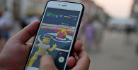 Игровое приложение Pokemon Go от компании Nintendo на экране мобильного телефона.