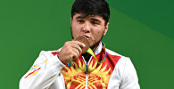 Тяжелоатлет из Кыргызстана Иззат Артыков на XXXI летних Олимпийских играх в Рио-де-Жанейро. Архивное фото