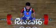 Архивное фото тяжелоатлета из Кыргызстана Иззата Артыкова на XXXI летних Олимпийских играх в Рио-де-Жанейро в весовой категории до 69 кг
