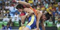 Борец Айсулуу Тыныбекова во время состязания на Олимпиаде в Рио-де-Жанейро. Архивное фото