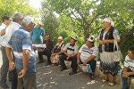 Жер көчкү жүргөн Алмалуу-Булак айылынын тургундары митингге чыгышты