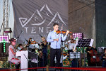 Музыканты на фестивале TENGRI music в столичном парке Победы имени Даира Асанова