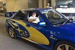Дзюдоист Юрий Краковецкий на подареноом ему автомобиле марки Subaru Impreza