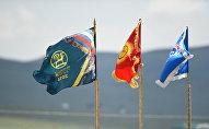 Логотип всемирных игр кочевников и флаг Кыргызстана. Архивное фото