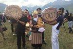 Базаргүл Мамырова жасап келген 15 килограммдык нан