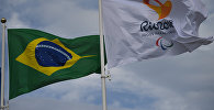 Флаги в Олимпийской деревне в преддверии XV летних Паралимпийских игр 2016 в городе Рио-де-Жанейро. Архивное фото