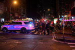 Нью-Йорк шаарындагы жардыруу болгон аймактагы полиция жана өрт өчүрүү кызматкерлери