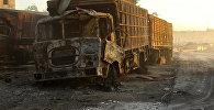 Поврежденный грузовик который подвергся обстрелу в районе Урум аль-Кубра к северо-западу от города Алеппо