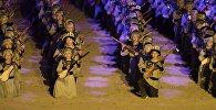 Тысячи комузистов во время исполнения композиции Маш ботой на открытии вторых всемирных играх кочевников