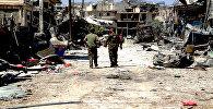 Архивное фото бойцов сирийской армии на территории освобожденного района Рамусе на юге Алеппо