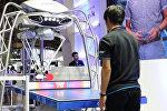 Робот для конвейеров мастерски сыграл в пинг-понг на выставке в Японии