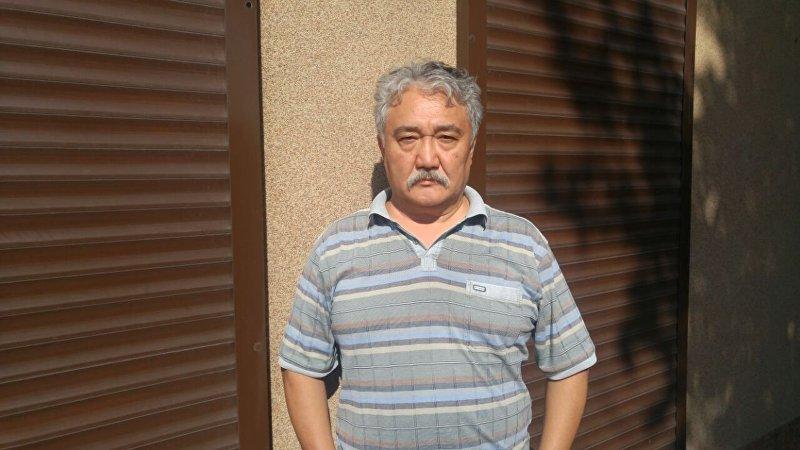 Архивное фото политолога Бакыта Бакетаева