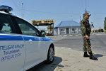 Чечен республикасындагы полиция кызматкери. Архивдик сүрөт