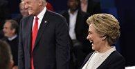 Кандидат в президенты США республиканец Дональд Трамп и кандидат в президенты от Демократической партии Хиллари Клинтон на вторых предвыборных теледебатах