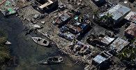 Разрушенные дома после урагана Мэтью в Корейл, Гаити