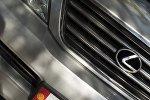 Логотип автомобоильной марки Lexus японской корпорациии Toyota Motors