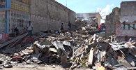 Спутник_Жизнь на руинах: гаитяне после урагана Мэтью разбирают завалы домов