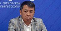 Кыргызстандык оор атлетчи Иззат Артыковдун машыктыруучусу Үсөнкан Майназаров