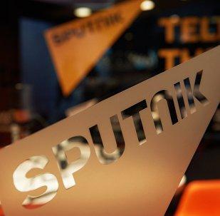 Эл аралык Sputnik маалымат агенттиги жана радиосунун логотиби