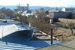 Балыкчы шаарында 18-19-октябрда болгон катуу шамалдын кесепети. Архивдик сүрөт